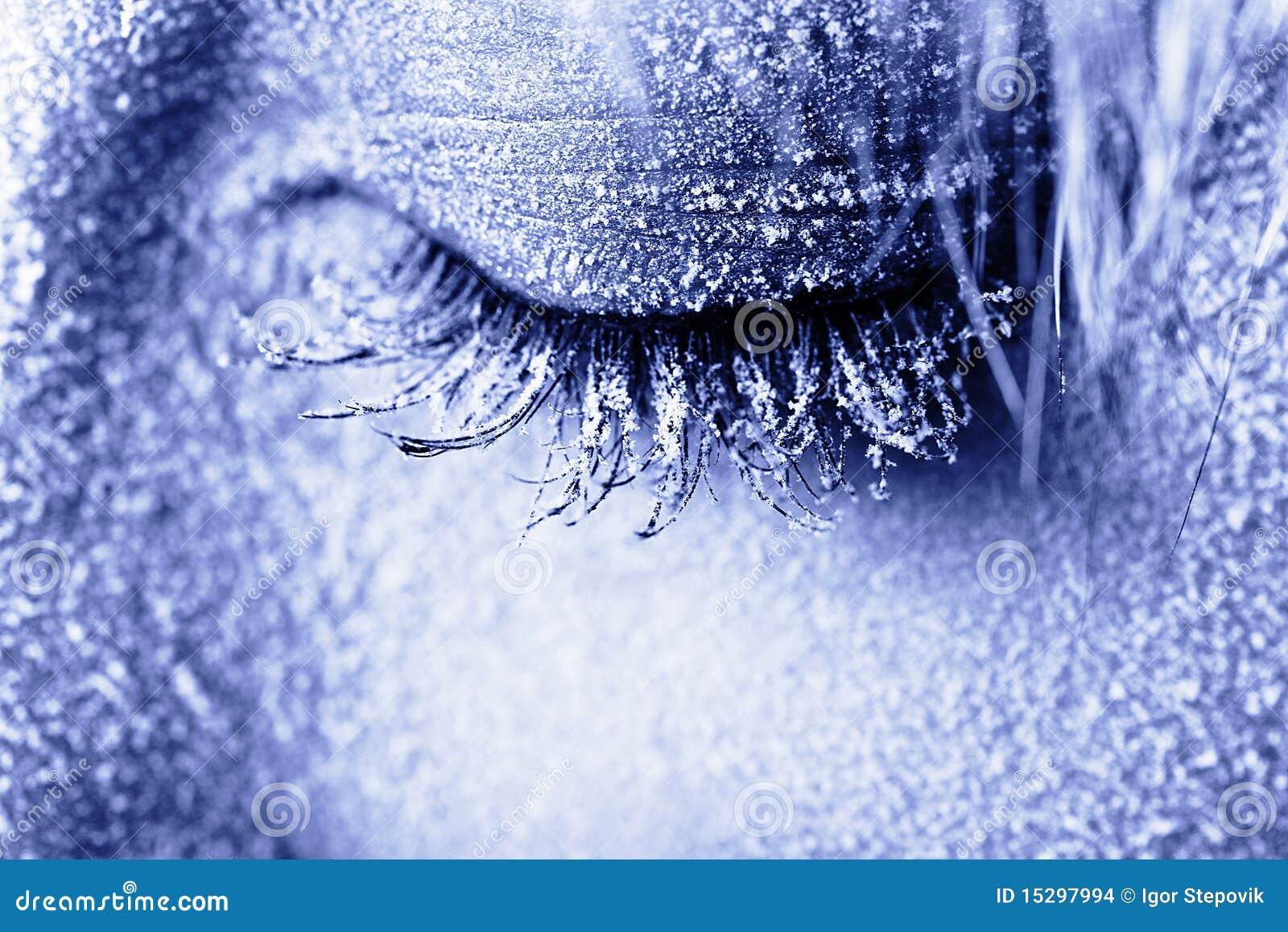 Frozen woman s eye covered in frost