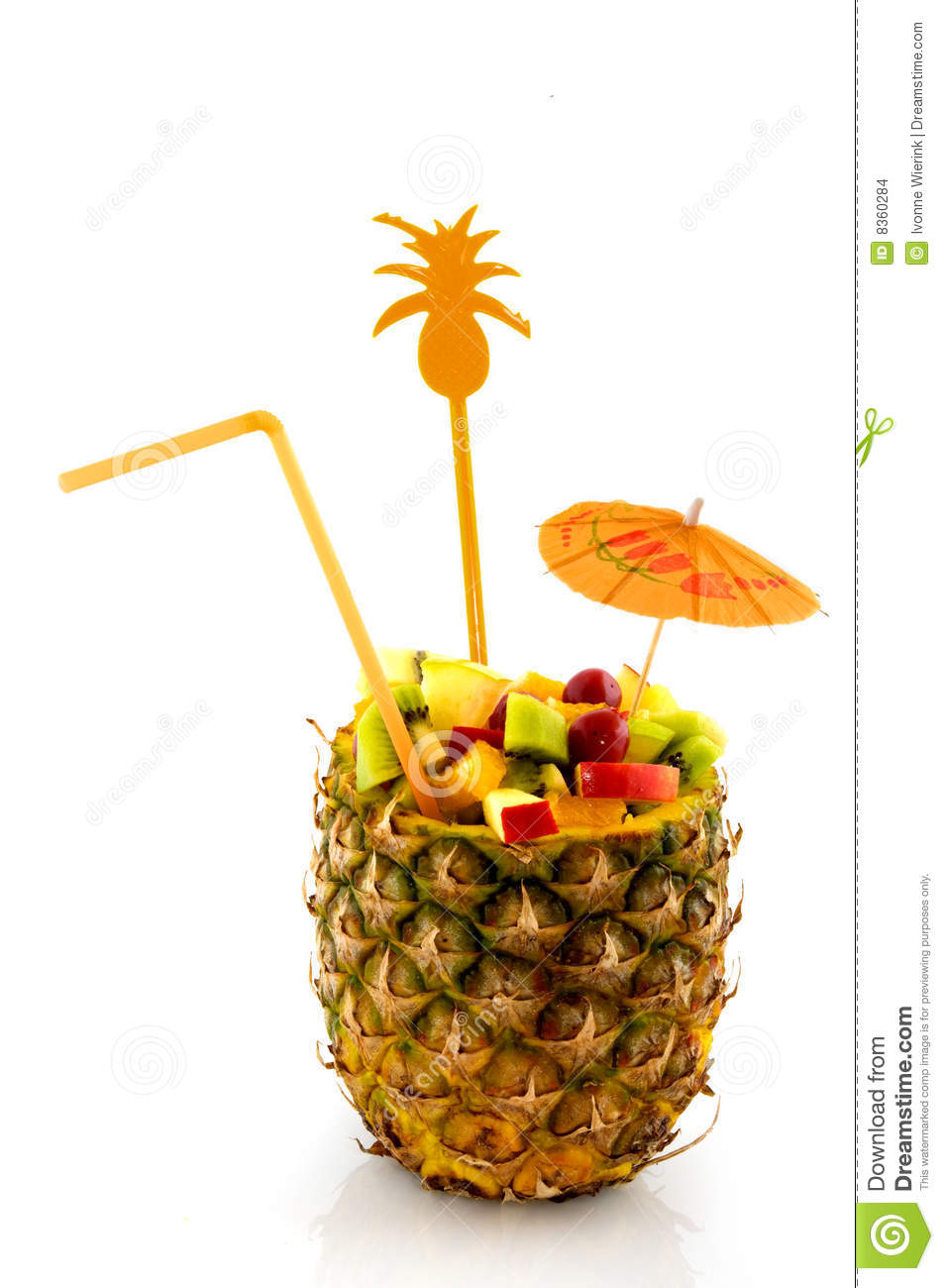 Tropical fruit cocktail prepared in pineapple.