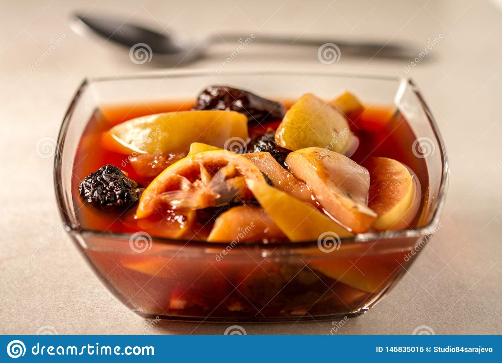 Fruit Compote in Clear Bowl and Clean Bakcground