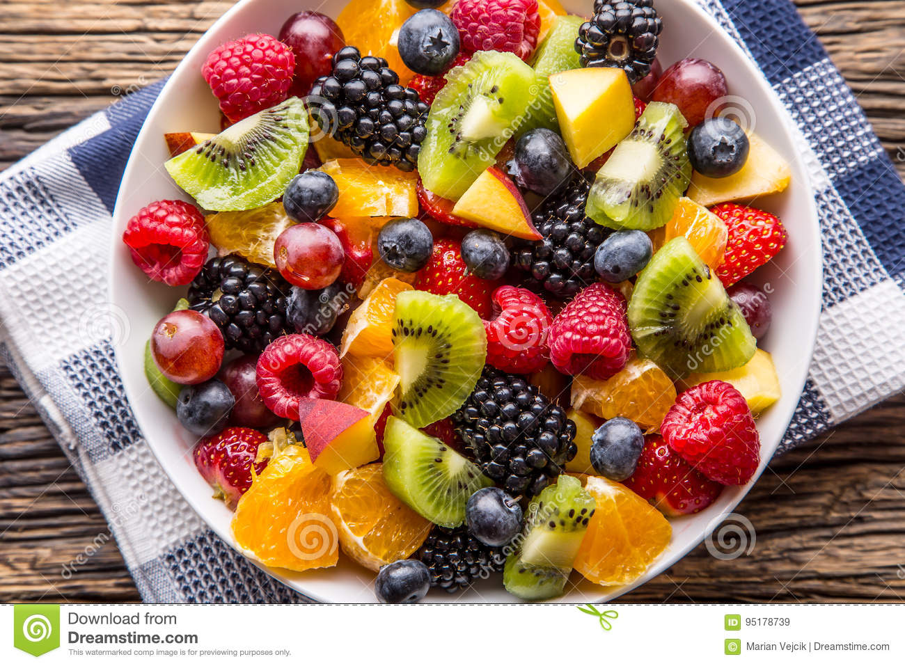 Fruit fresh mixed tropical fruit salad. Bowl of healthy fresh fruit salad - died and fitness concept