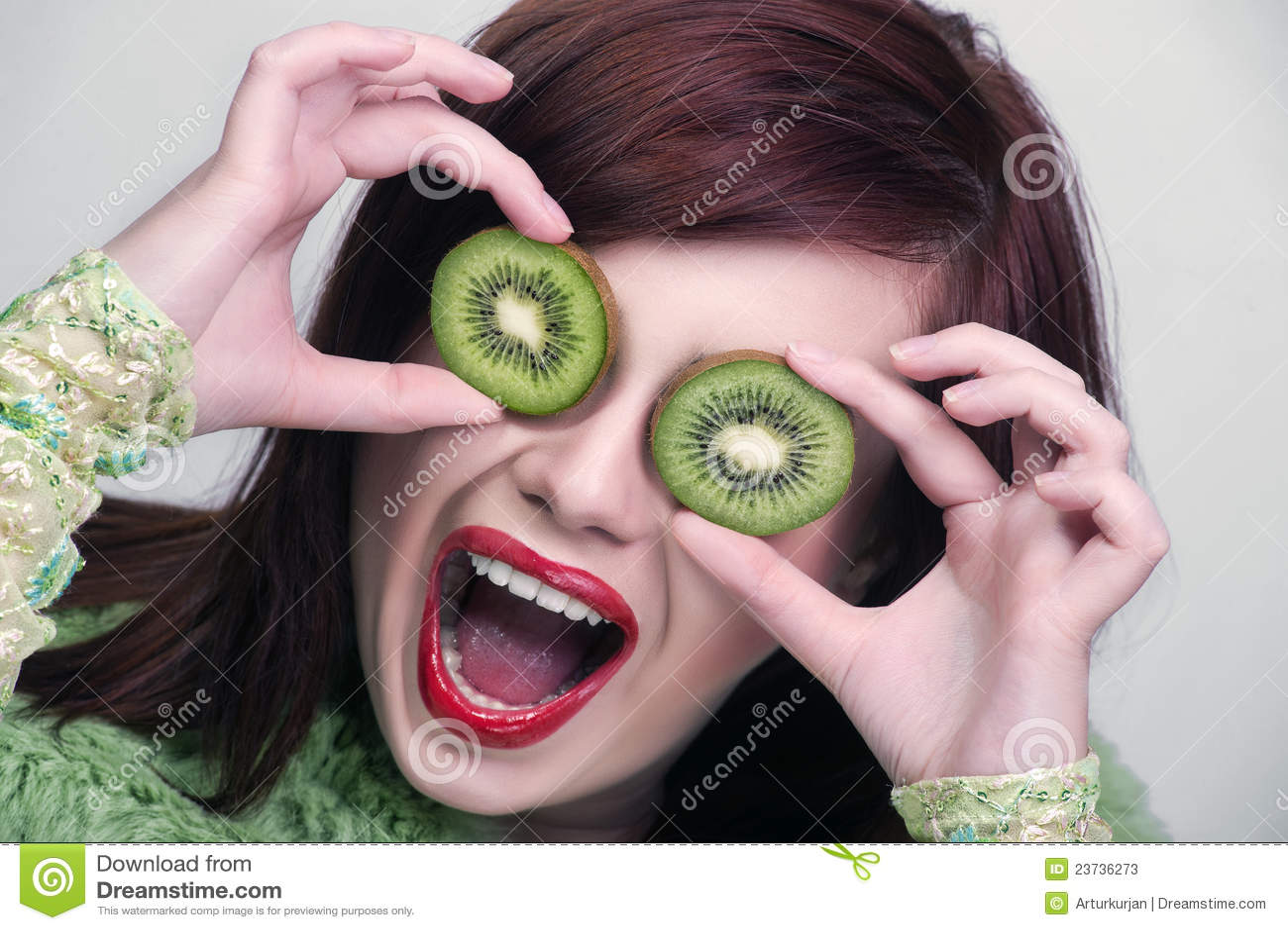 Fruit funny woman holding kiwi