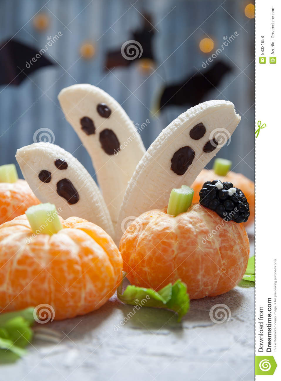 Fruit Halloween Treats. Banana Ghosts and Clementine Orange Pumpkins