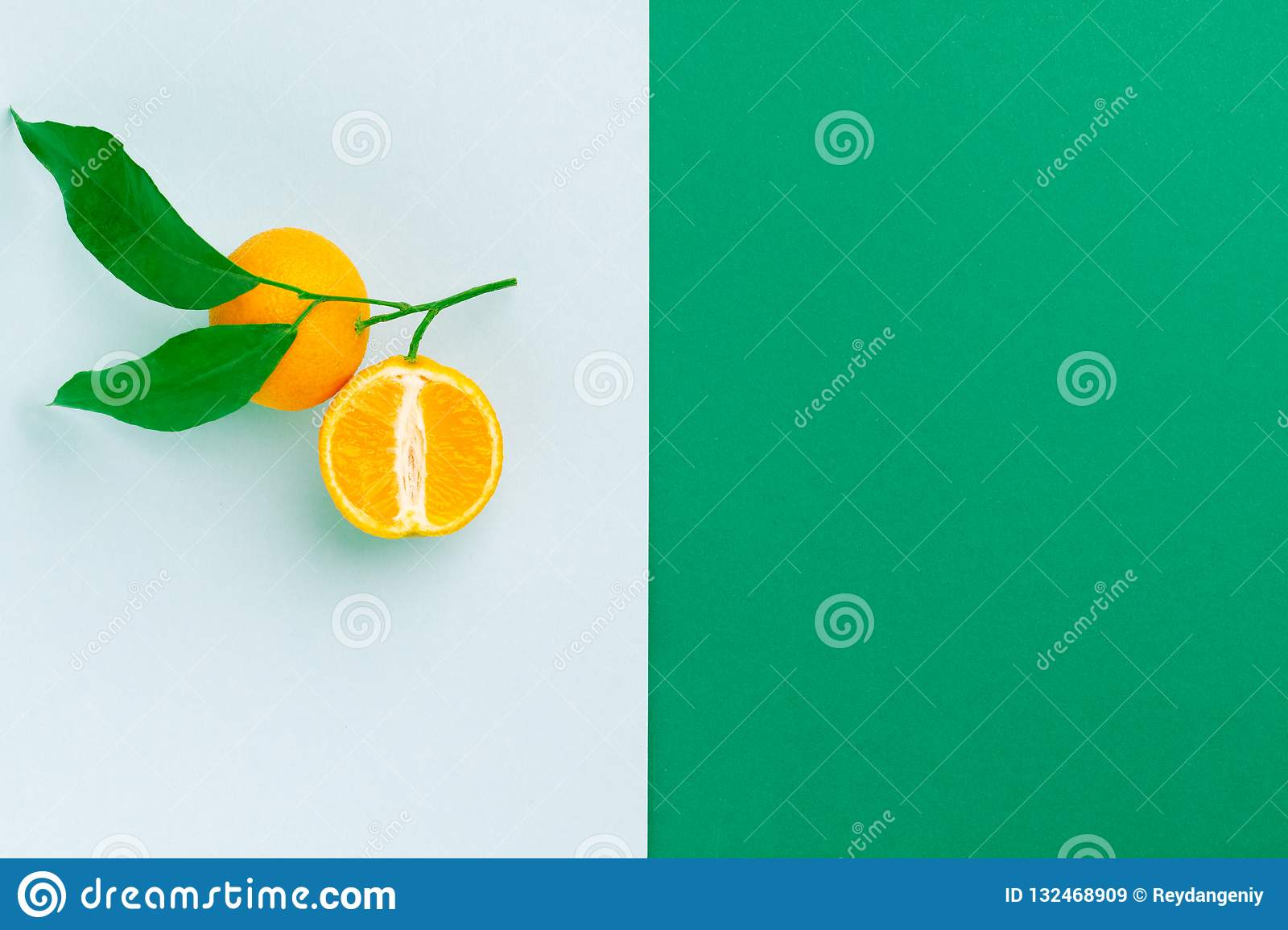 Fruit layout: yellow oranges with green leaves.