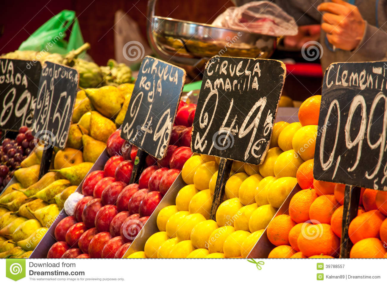 ... full of fresh fruits with price labels in market in Barcelona, Spain