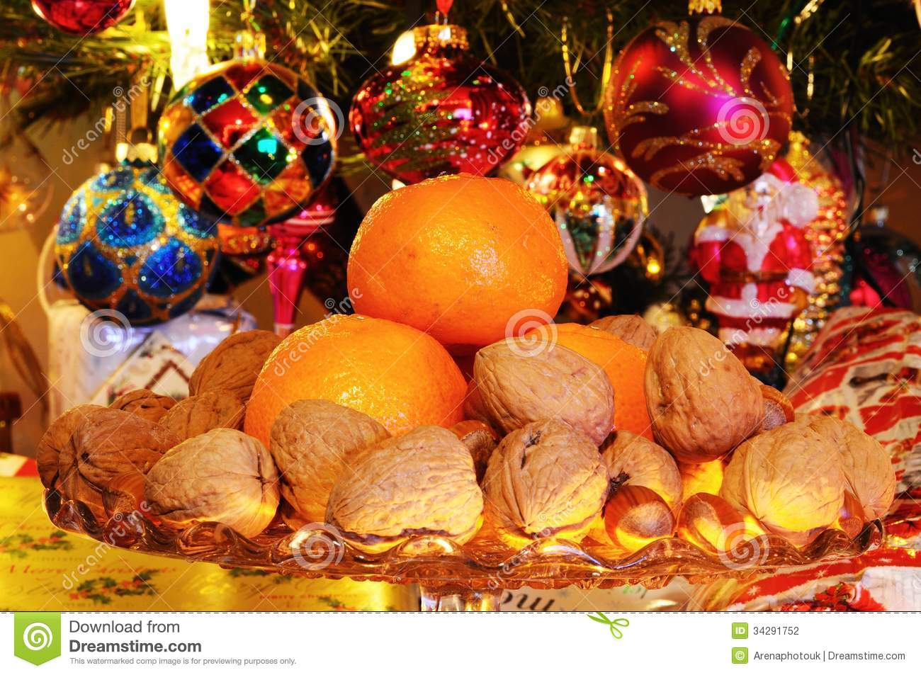 Fruit and nuts with christmas tree to rear stock photo