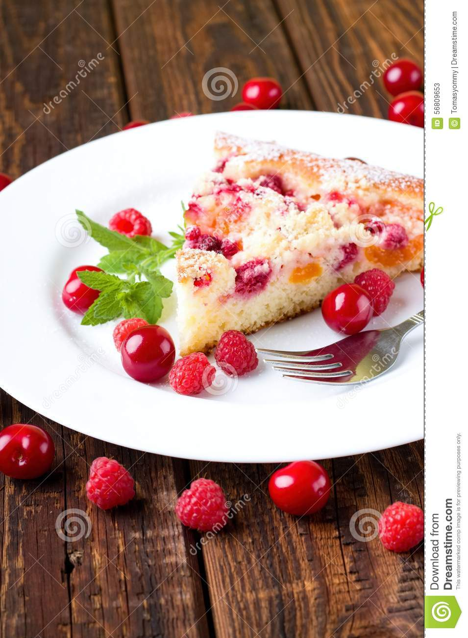 Fruit pie on white plate with berries