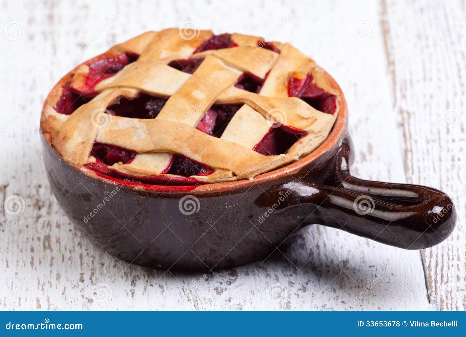 Fruit pie on white table