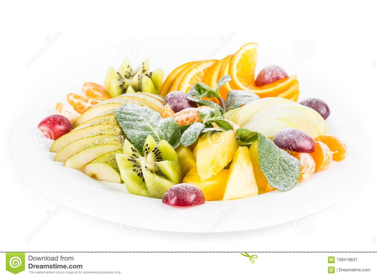 Fruit plate, isolated. apple, mandarin, kiwi, grapes, mint, pear, apple, pineapple. Fruits salad in plate close-up