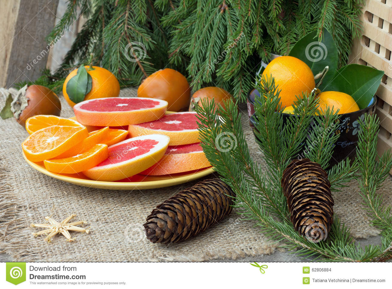 Christmas Tree Fruit Platter.Fruit Platter And Christmas Tree Branches With Cones Stock