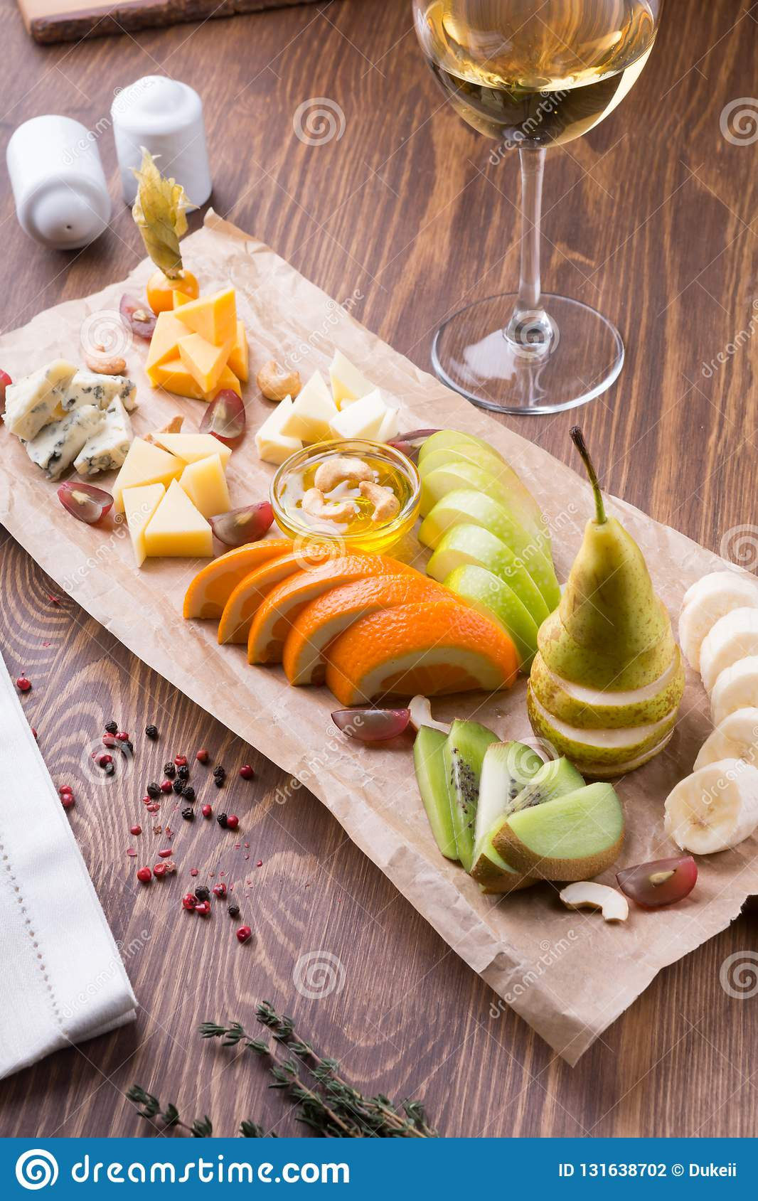 Fruit Platter Full Of Snacks For White Wine Served On A Wooden Table Stock Photo Image Of Board Banana 131638702