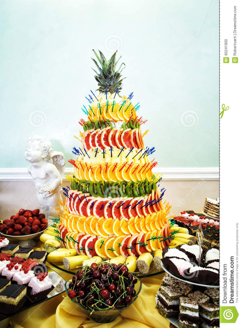 fruit pyramid decoration cakes and cookies at dessert table at stock photo image of gourmet. Black Bedroom Furniture Sets. Home Design Ideas