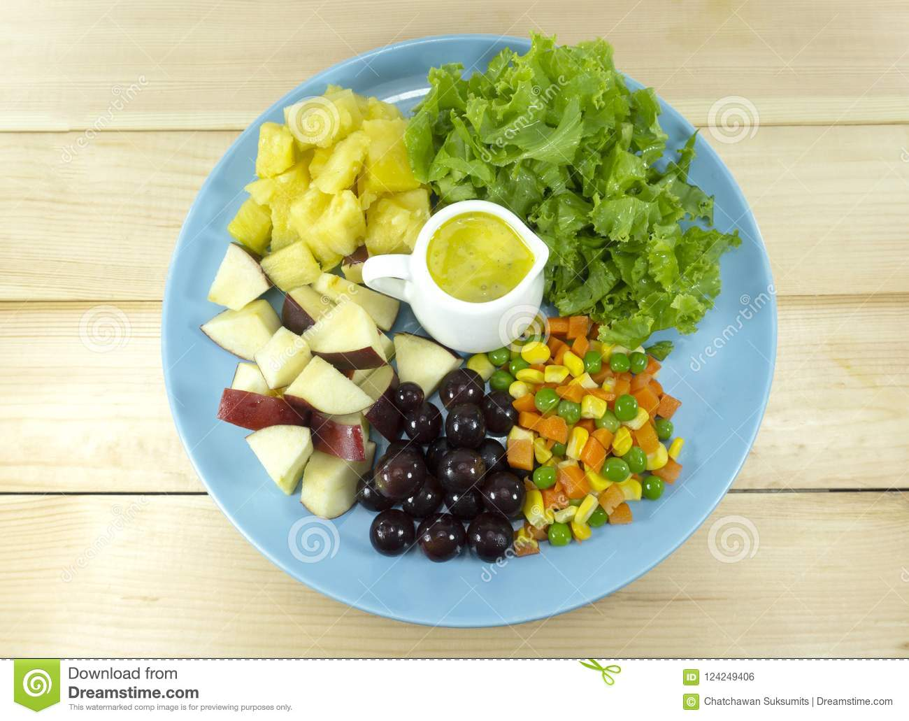 Fruit Salad With Fresh Vegetables In A Blue Plate Stock Photo
