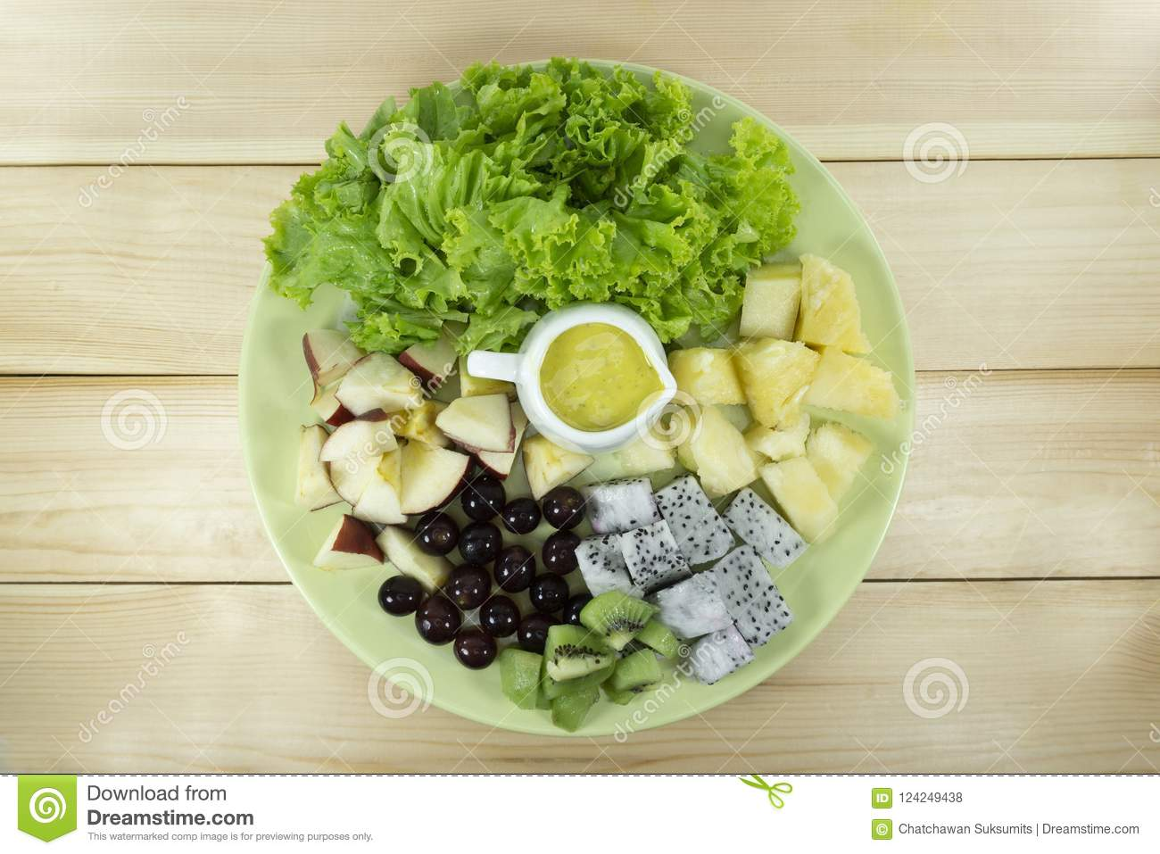 Fruit Salad With Fresh Vegetables In A Green Plate Stock Photo