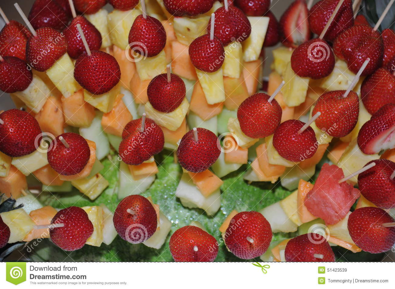 Fruit Salad With Skewered Strawberries, Pineapple And Melon Pieces ...