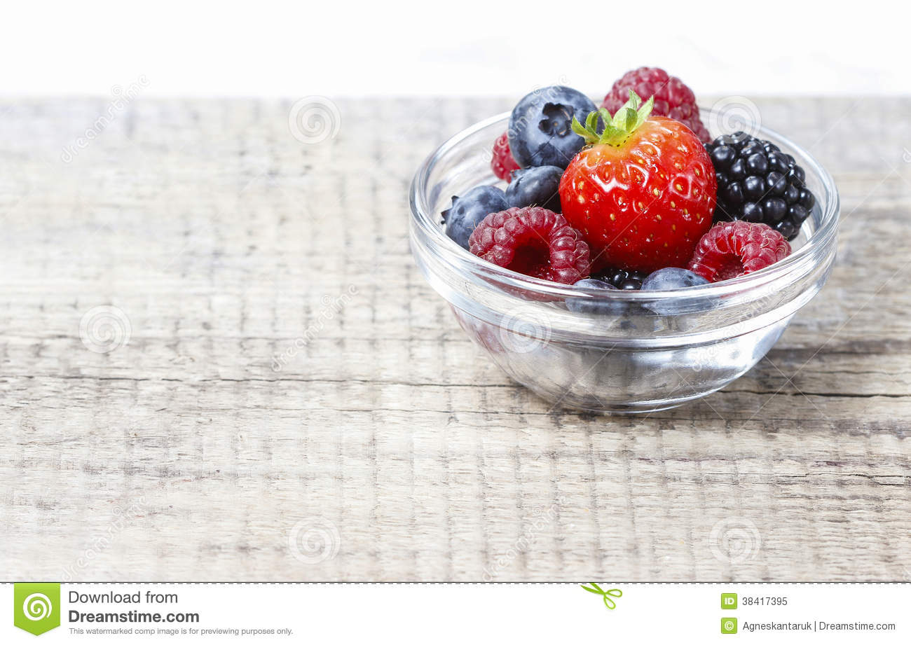 Fruit Salad In Small Transparent Bowl On Wooden Table