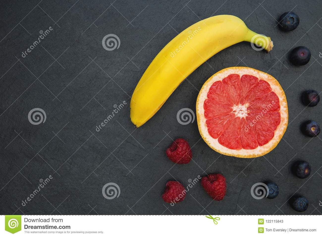 Fruit selection on dark food background copy space
