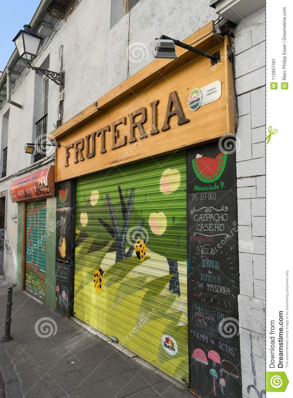 Fruit Shop With Vibrant And Colourful Graffiti On Entrance