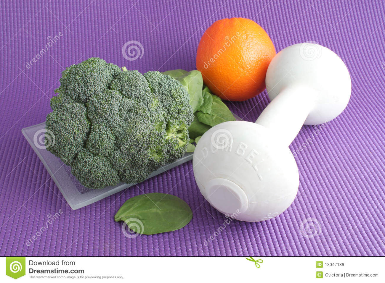 Fruit And Vegetables With Exercise Equipment Royalty Free