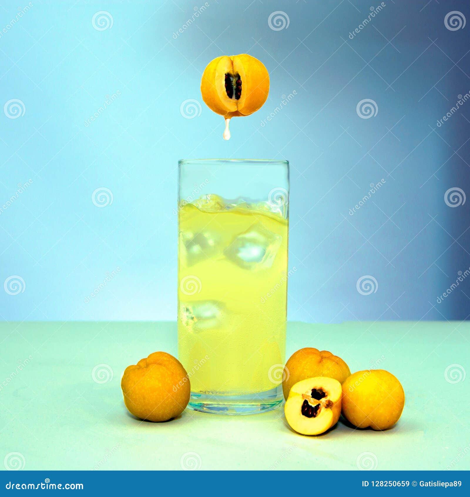 Fruite juice splash isolated on white and the ice