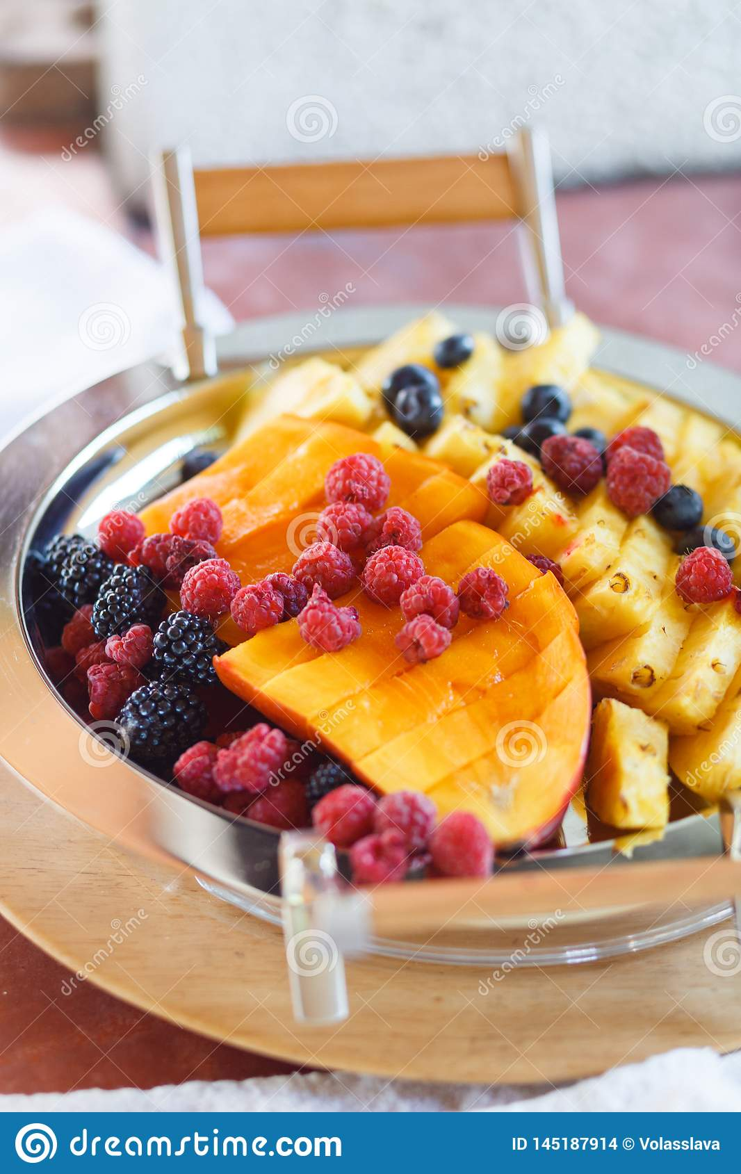 Fruits and berries are on the tray