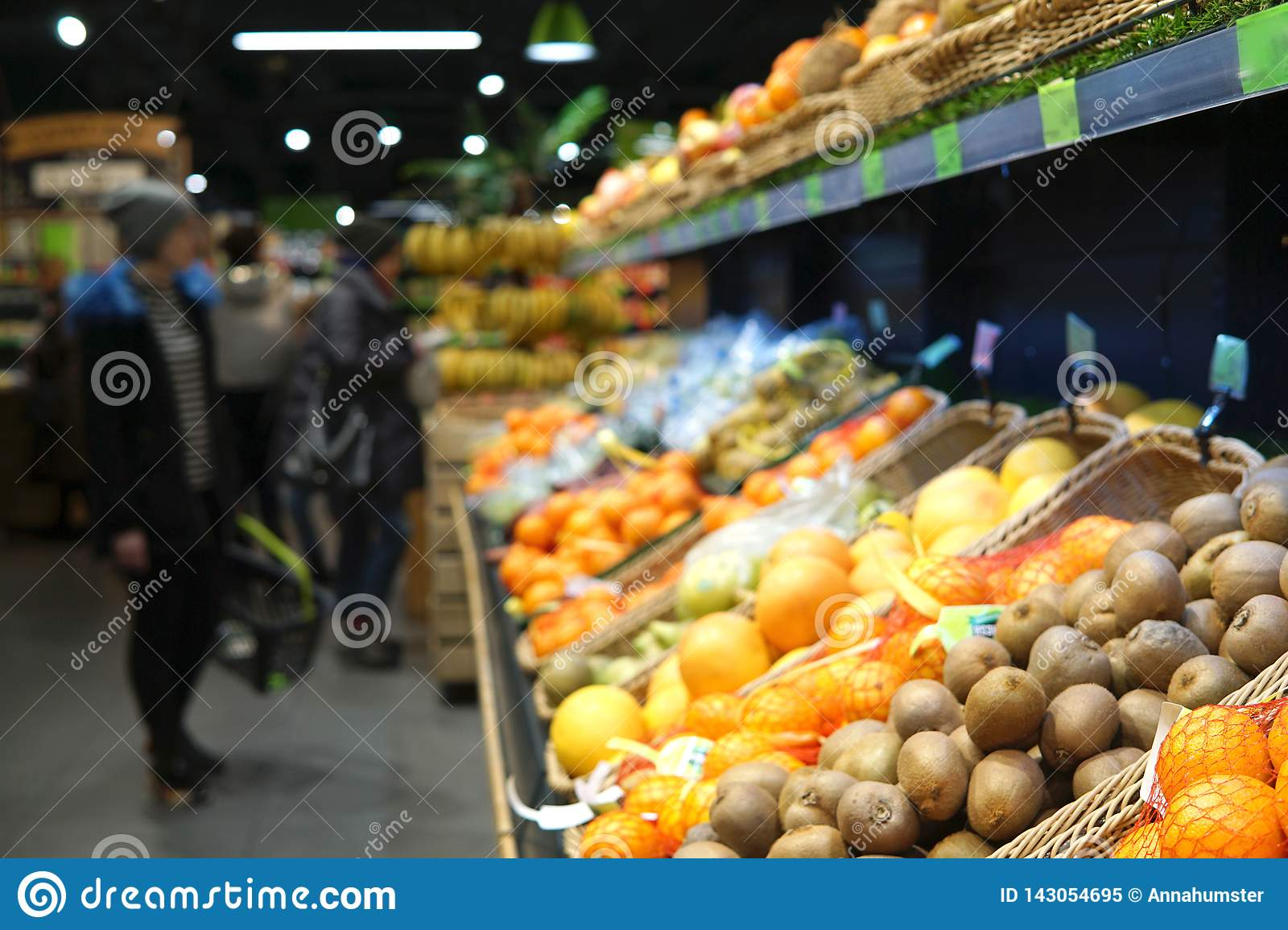 Fruits. Blurred image of supermarket.