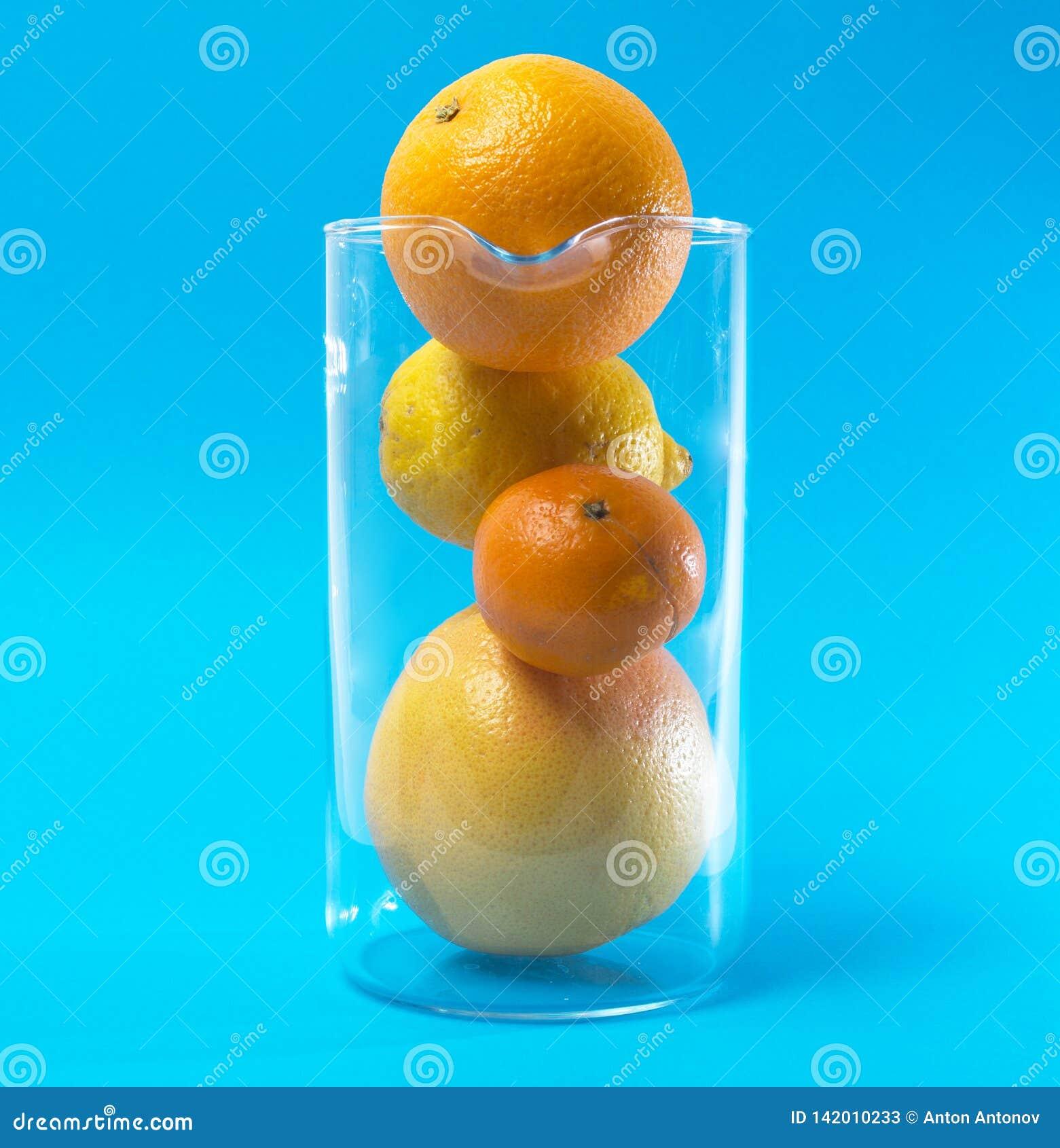 Fruits. Citrus.Fruit cocktail on a blue background.