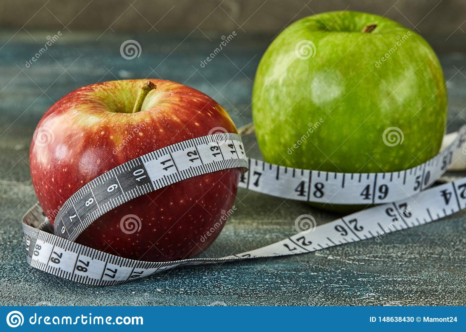 Fruits and meter on a blue with divorces background