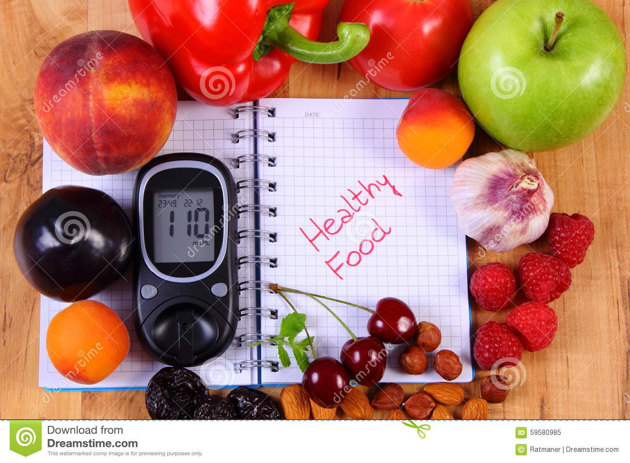 Fruits And Vegetables With Glucometer And Notebook For Notes