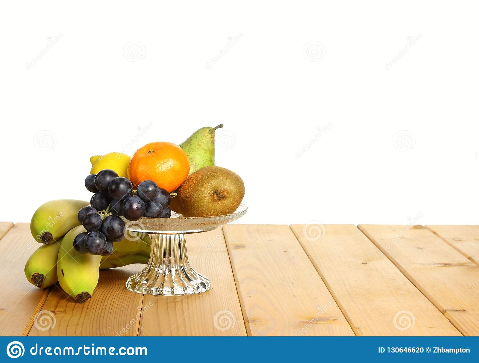 Frukt i en exponeringsglasbunke
