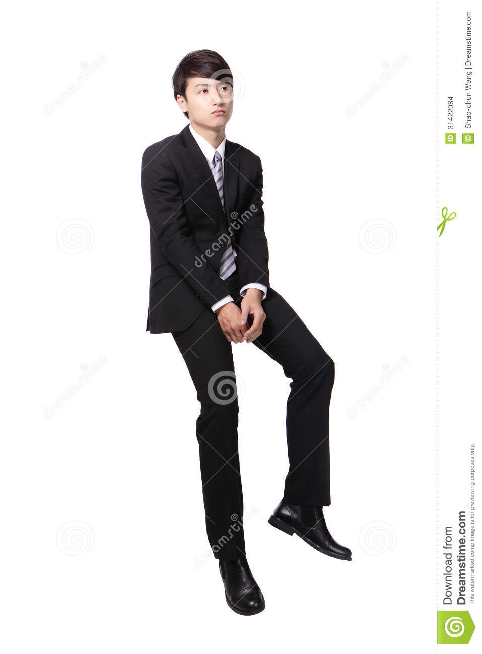 Frustrated business man sitting on something