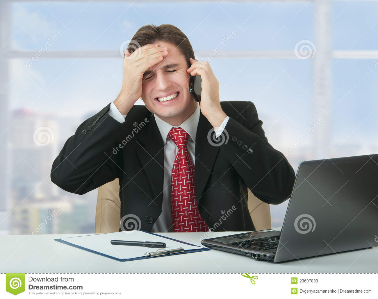Frustrated Business Man Talking On Phone Stock Image