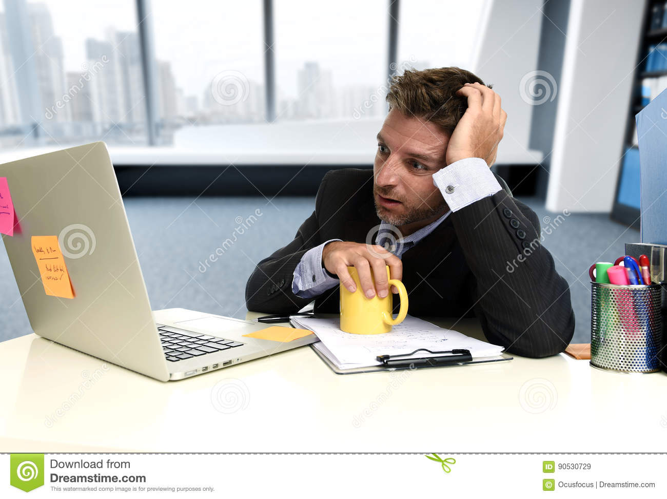 Frustrated businessman desperate face expression suffering stress at office computer desk