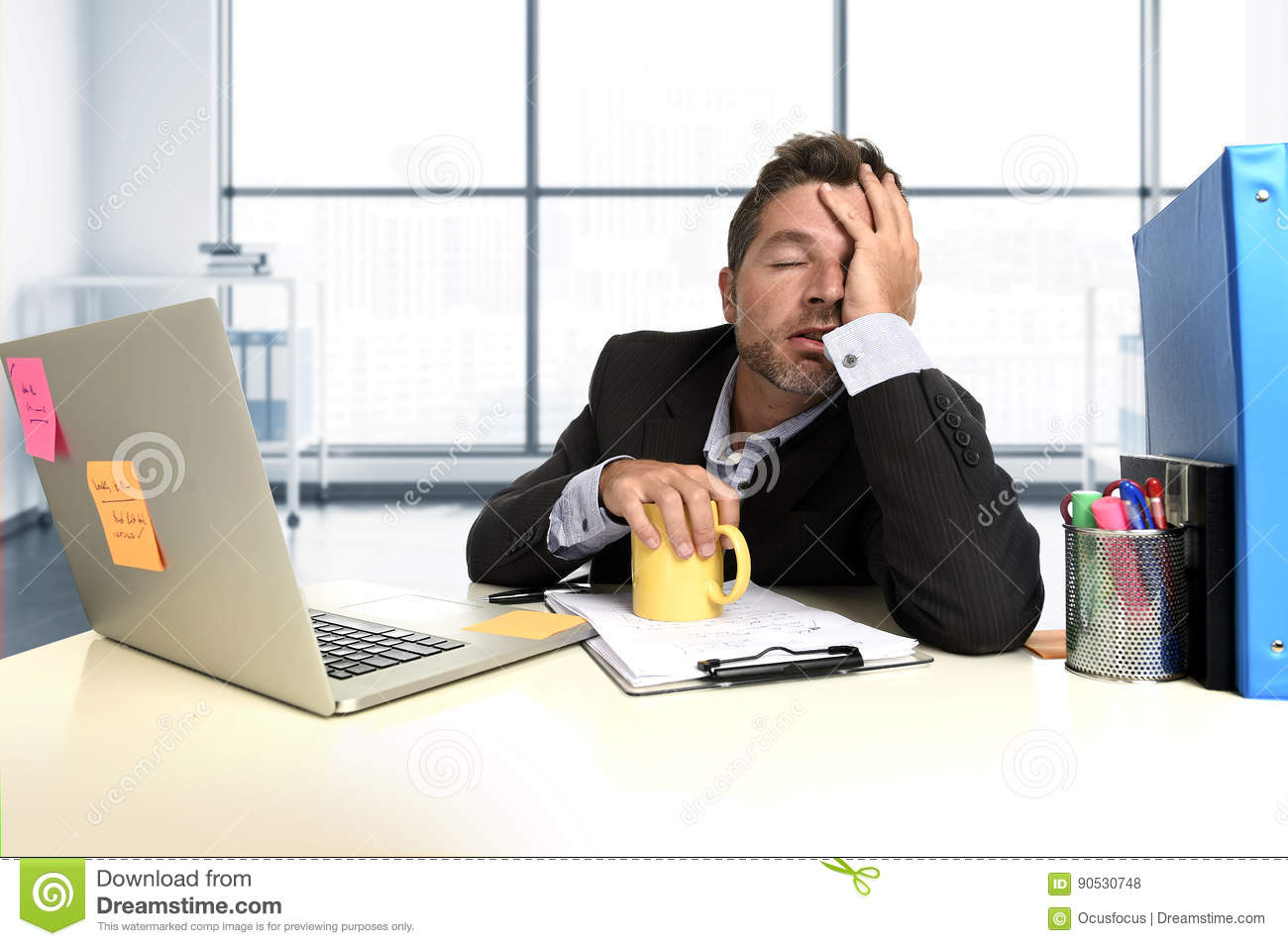 Frustrated office worker on the phone holding stock photo image - Royalty Free Stock Photo