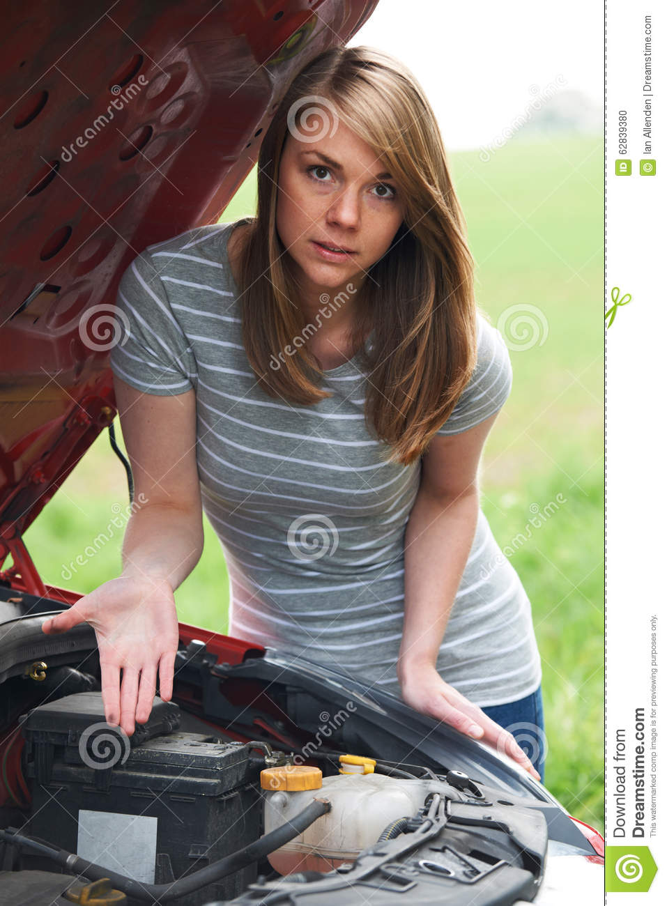 Frustrated Female Motorist With Broken Down Car