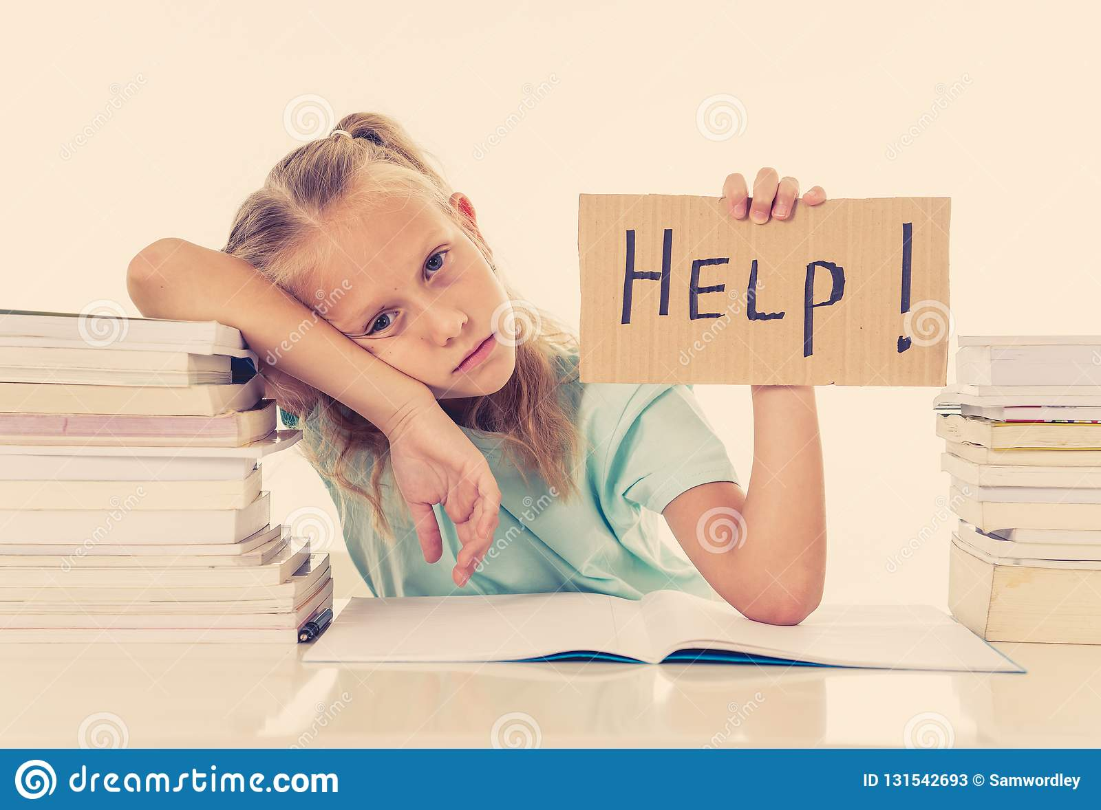 Frustrated little schoolgirl feeling a failure unable to concentrate in reading and writing difficulties learning problem