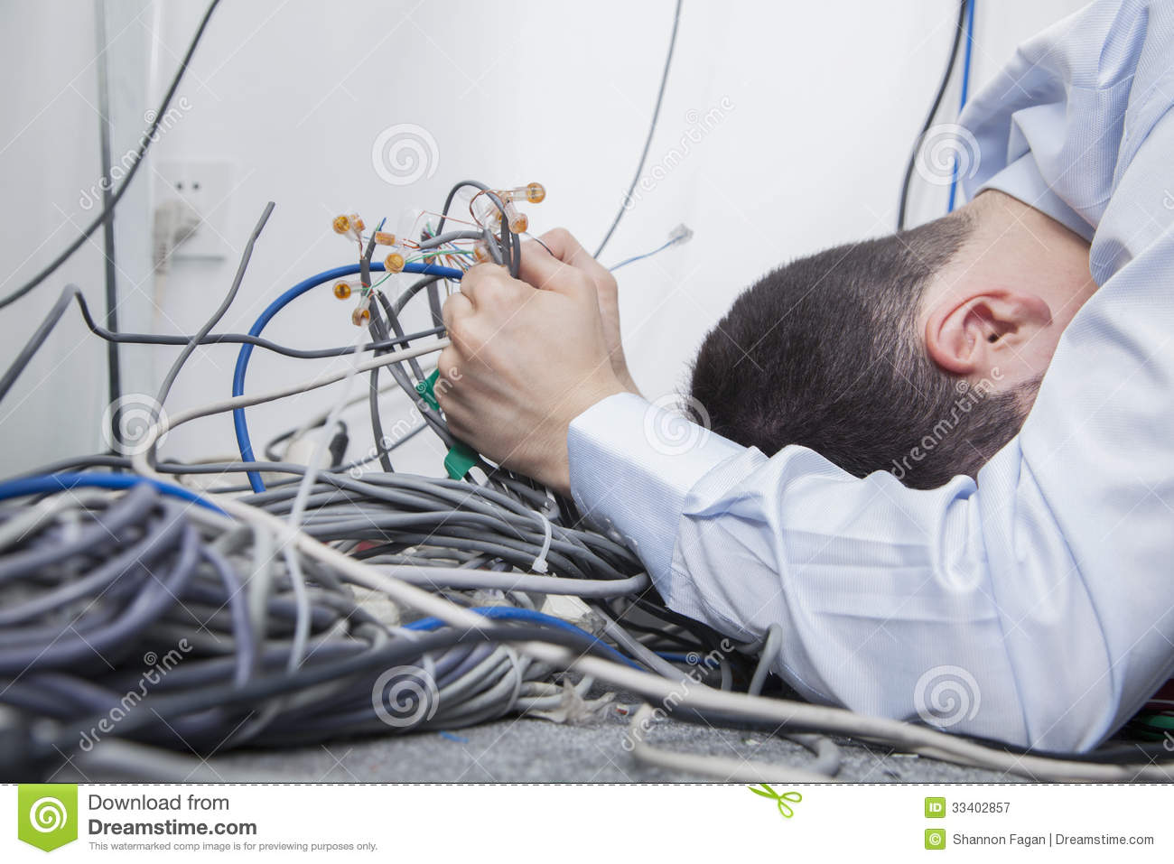 Frustrated Man Lying Down Trying To Figure Out And Sort