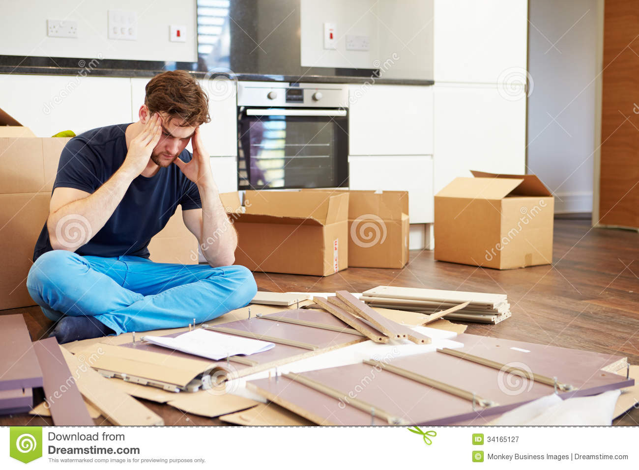Frustrated man putting together self assembly furniture for Someone to assemble ikea furniture