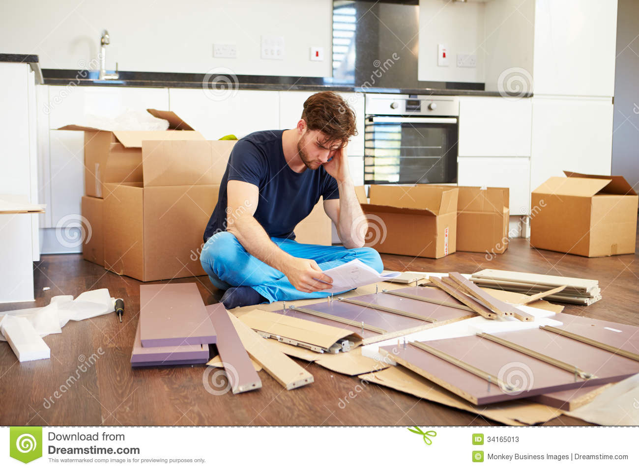 Self Assemble Furniture frustrated man putting together self assembly furniture stock