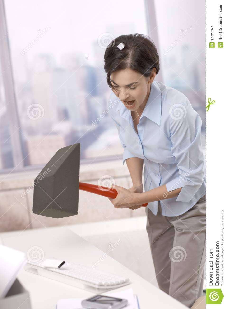 Frustrated office worker on the phone holding stock photo image - Frustrated Office Worker Smashing Keyboard Stock Image