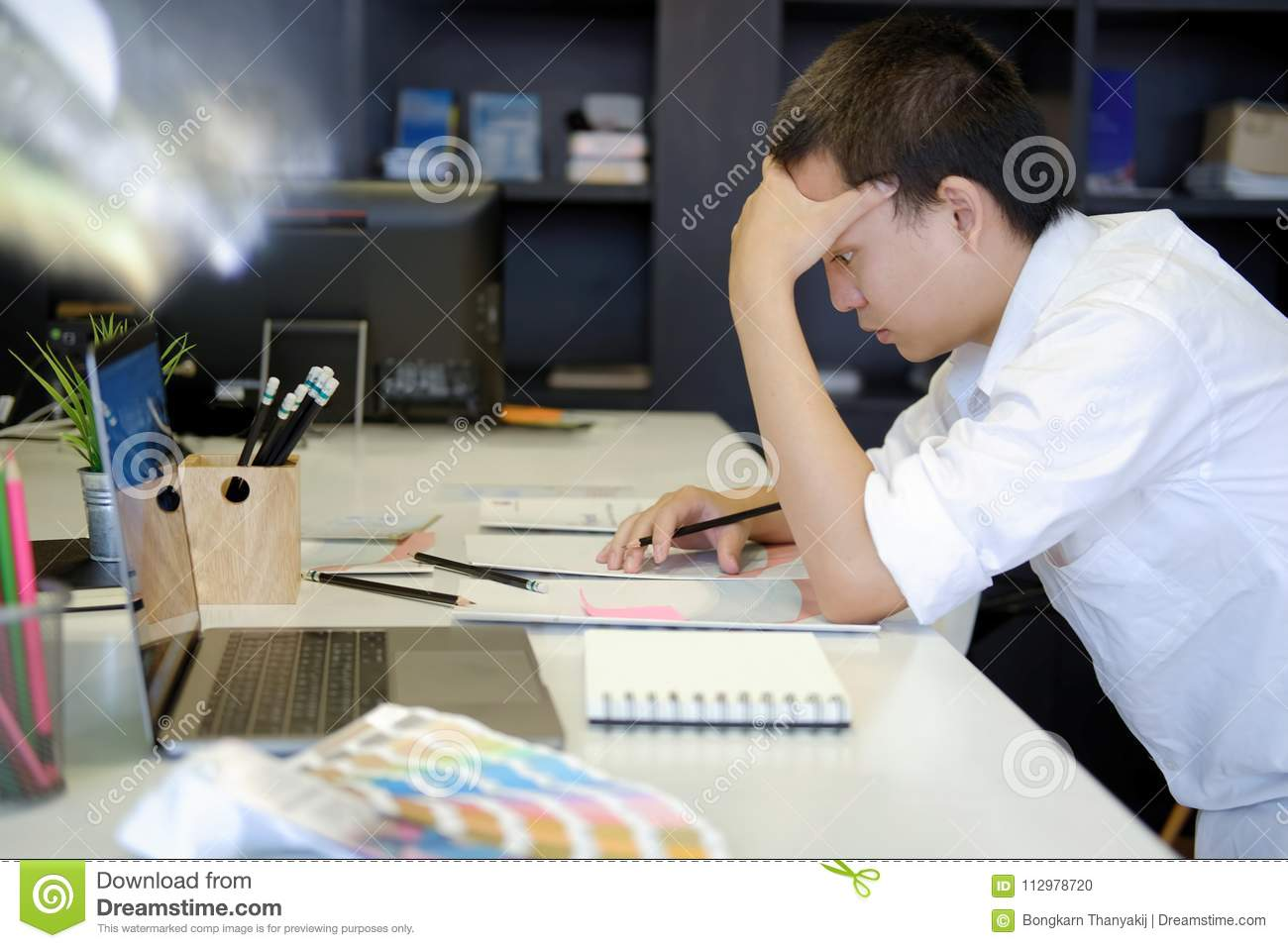 Frustrated stressed designer with job at office.