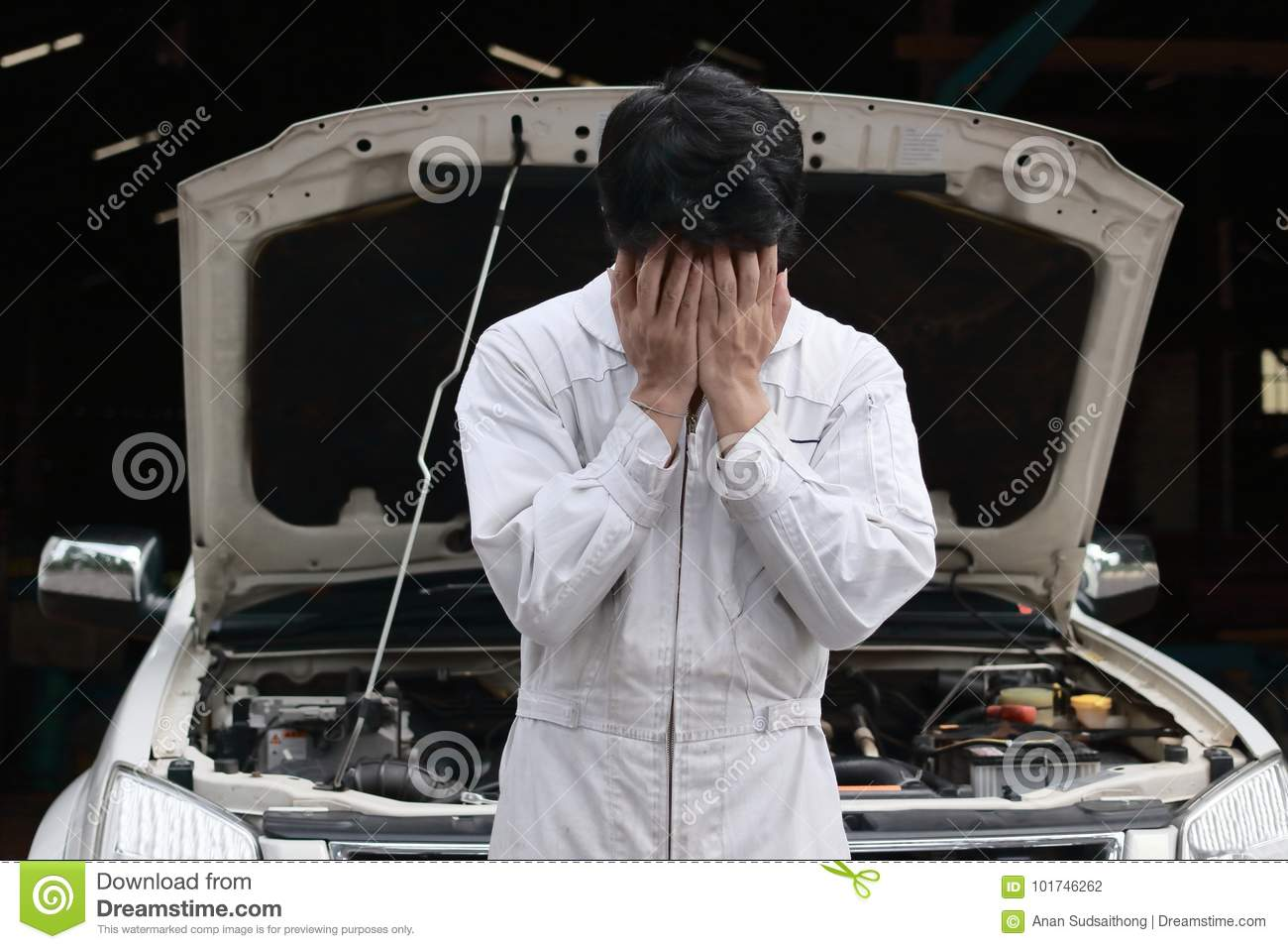 Hands On Garage : Frustrated stressed young mechanic man in white uniform