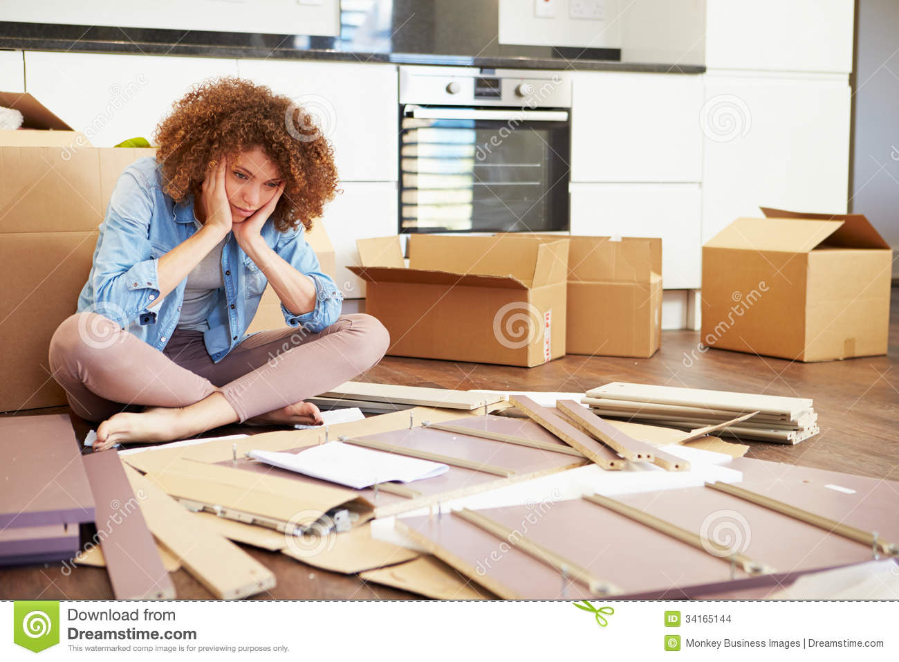 Frustrated Woman Putting Together Self Assembly Furniture Stock Images