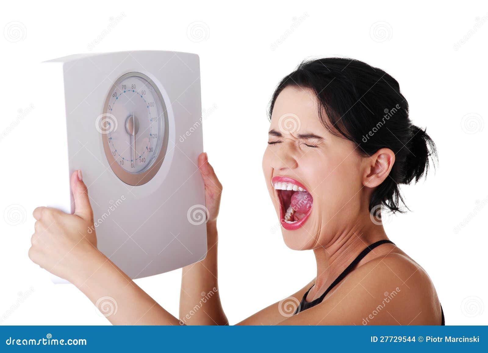 Frustrierte Frau mit Skala