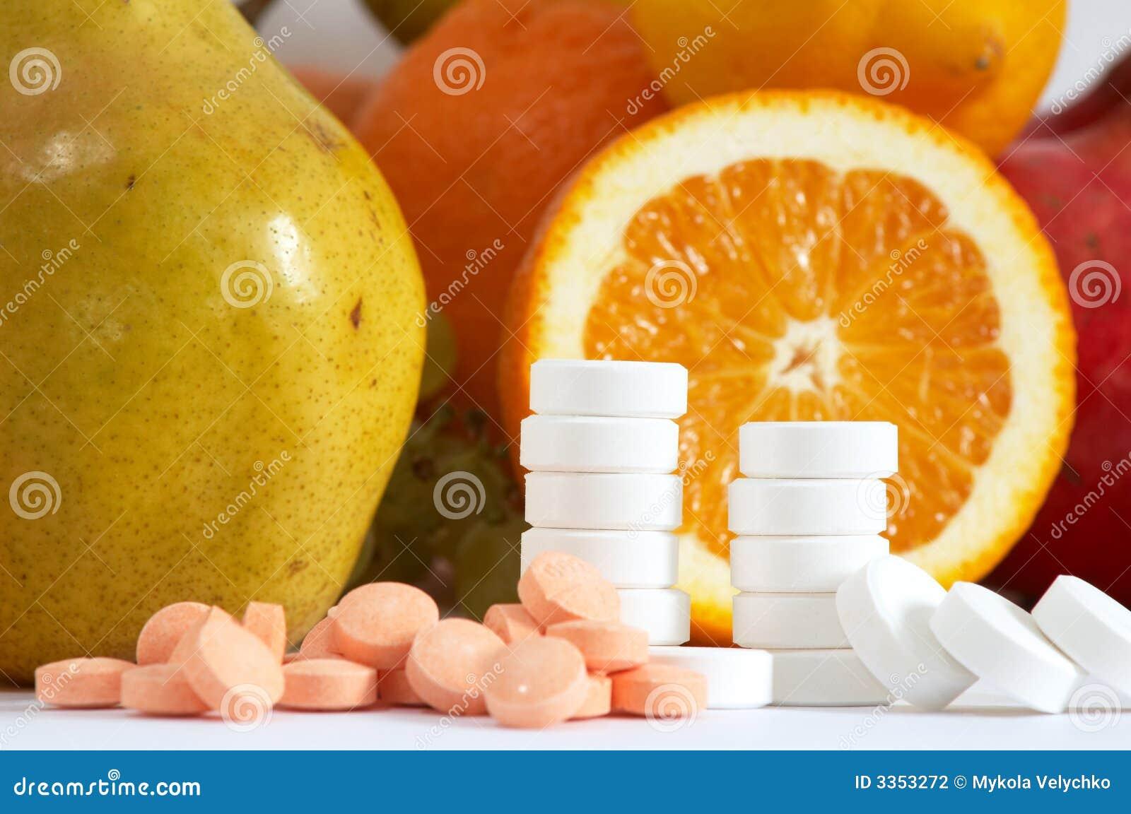 Frutas e comprimidos