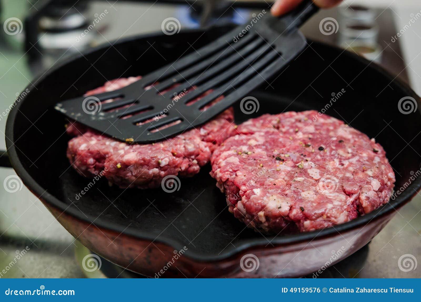 Frying raw burger