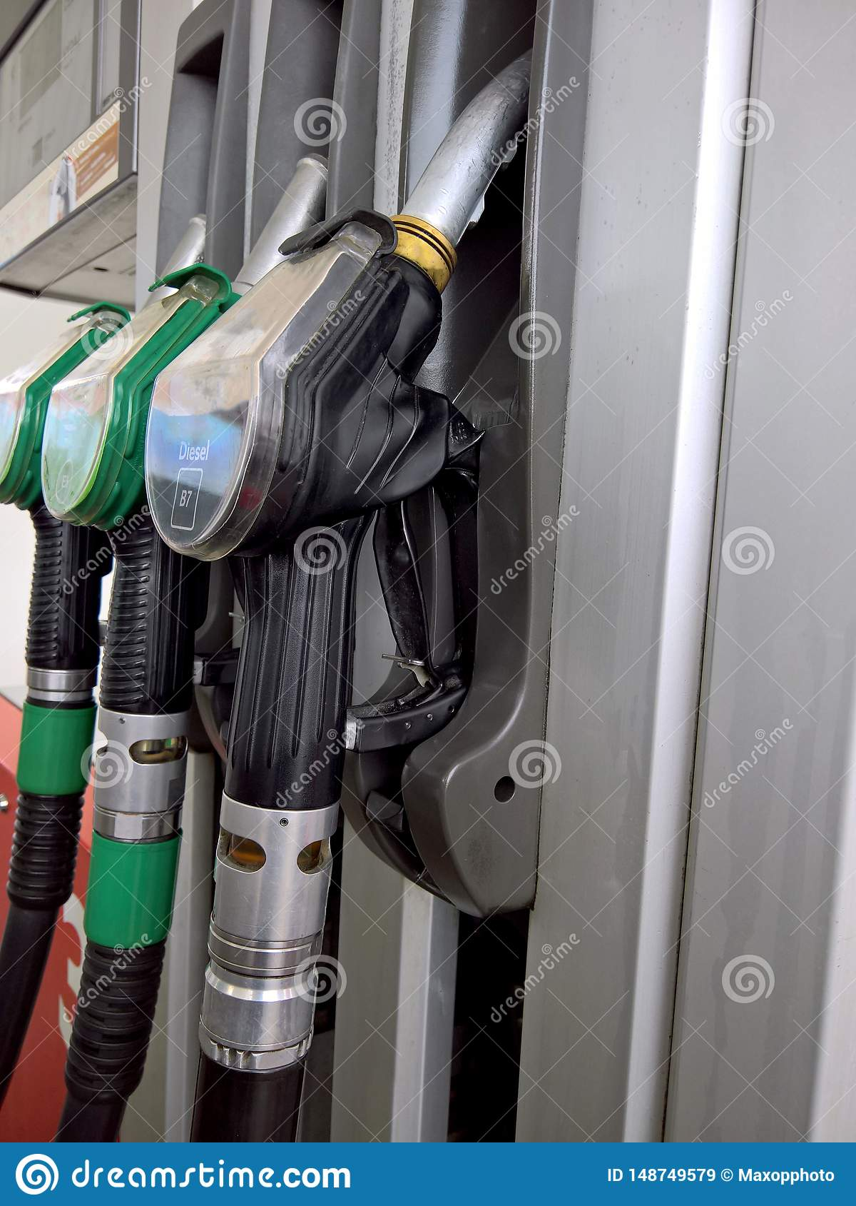 Fuel Guns At Gas Station With Petrol And Diesel Fuel For