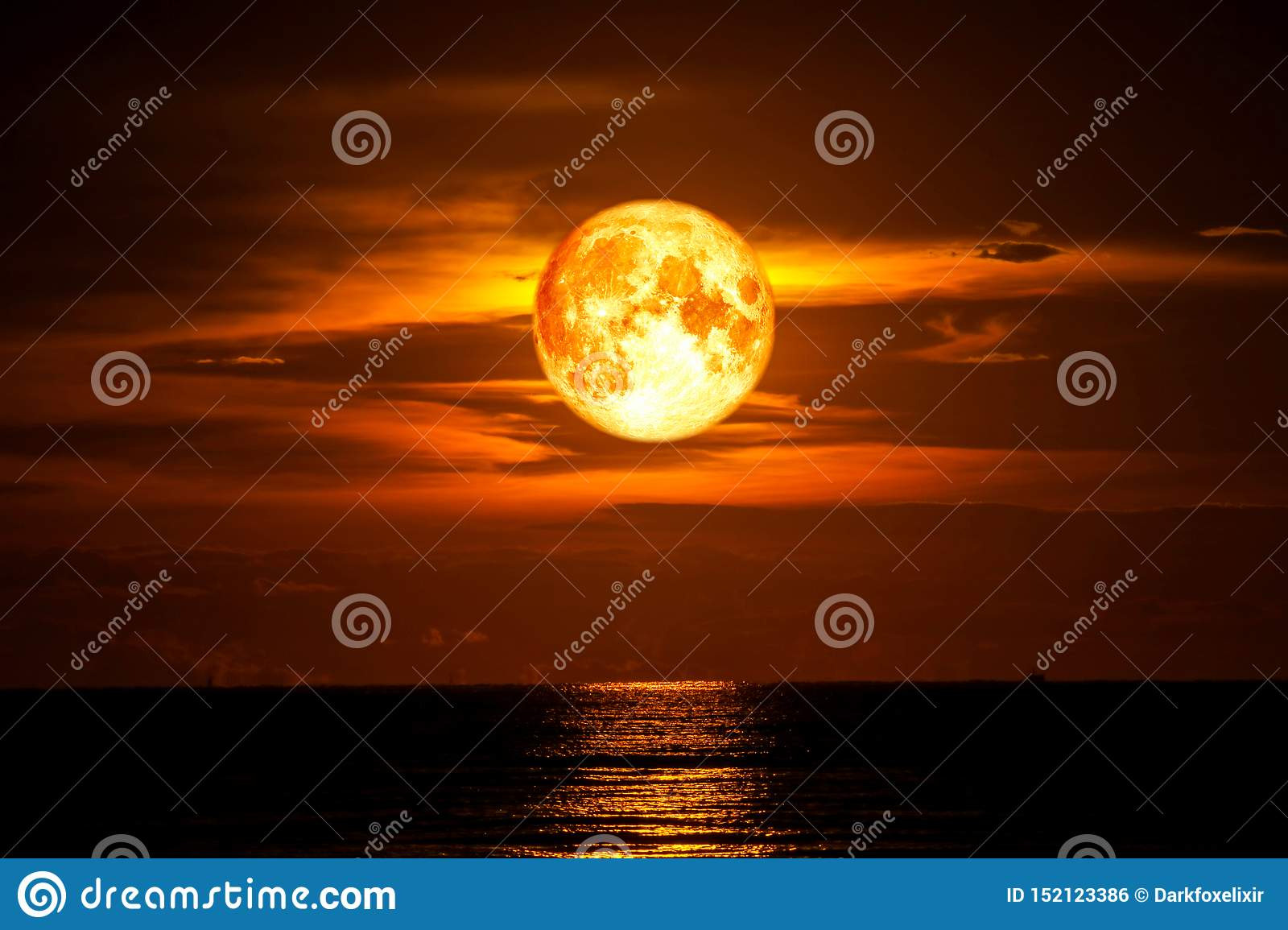 full blood moon on sea and ocean light sky silhouette cloud