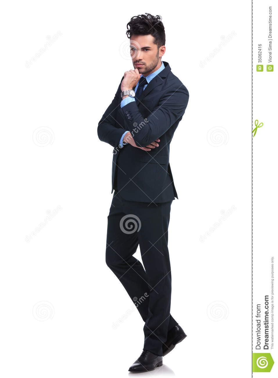 Full body picture of a serious pensive business man