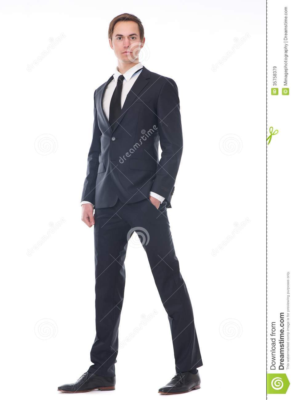Full Body Portrait Of A Handsome Young Businessman In Black Suit
