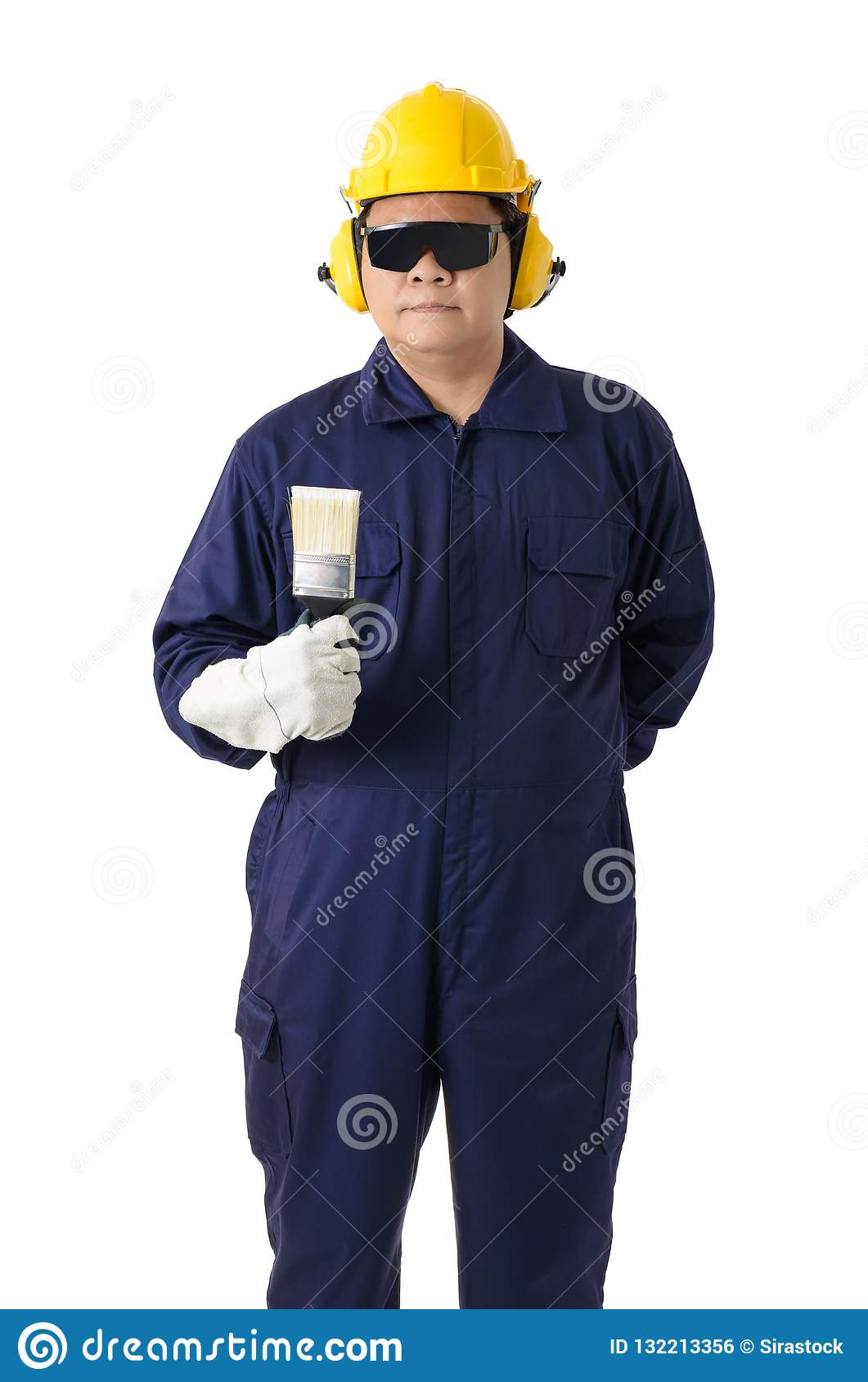 68b3d290a55 Full body portrait of a worker in Mechanic Jumpsuit is holding a paint  brush with helmet